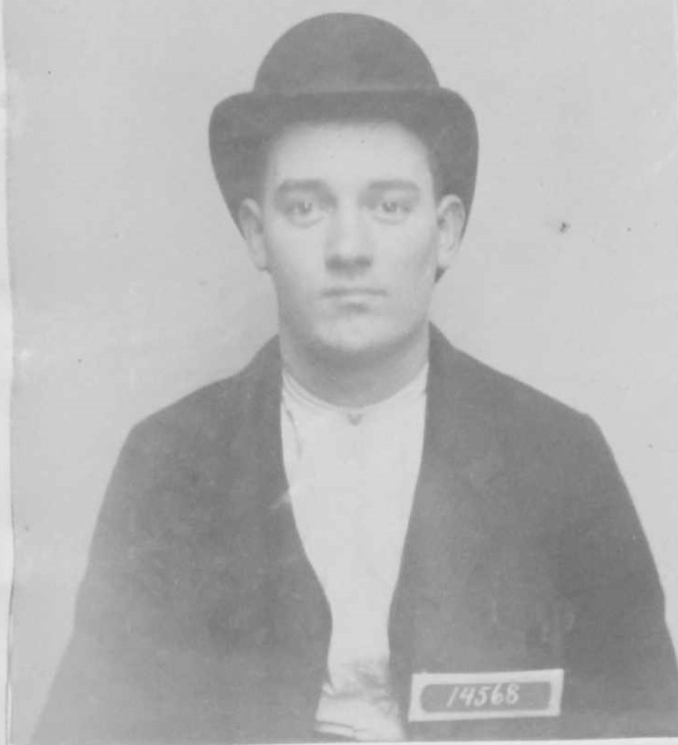 Young man in hat with San Quentin inmate numbers 14568.