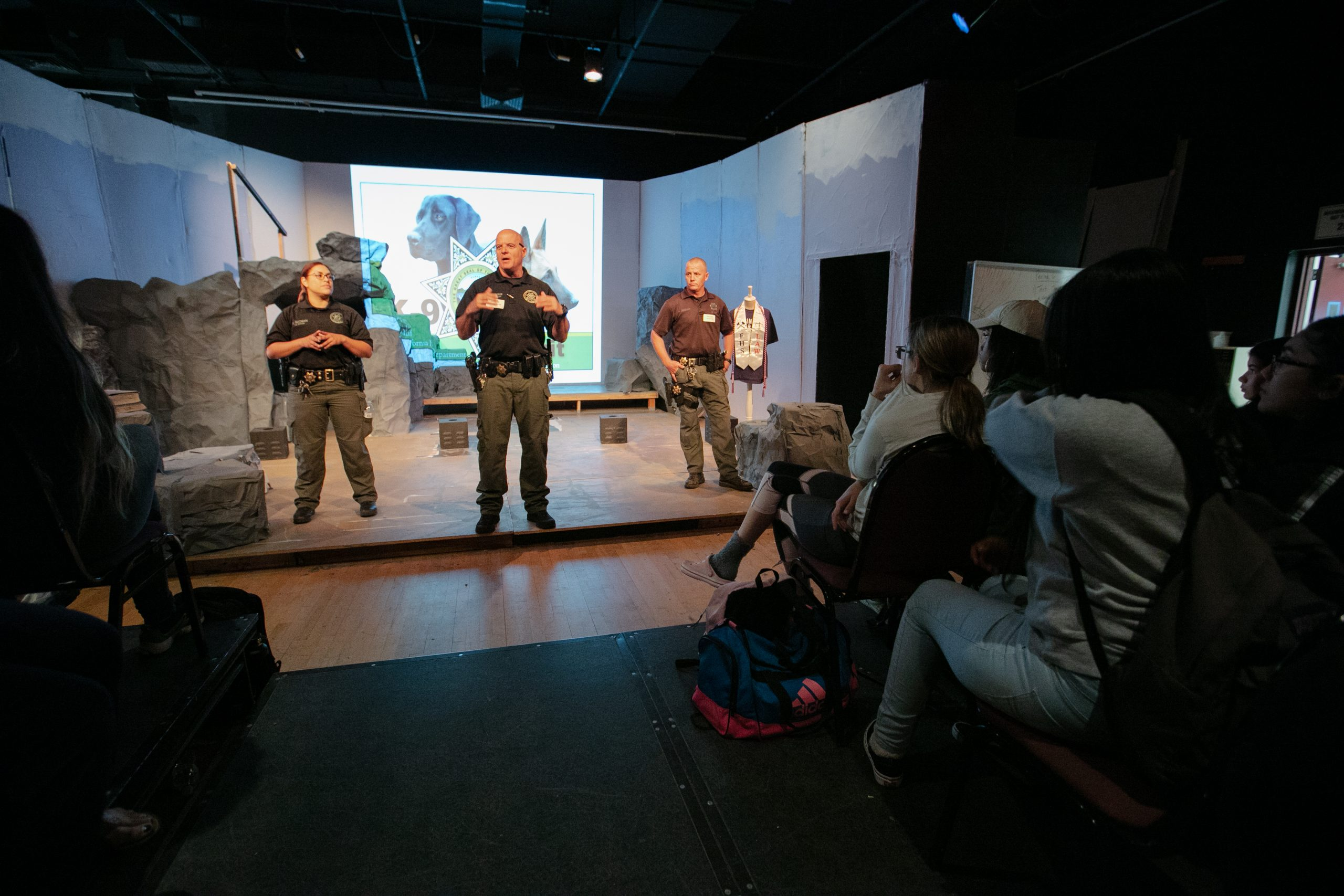 Three CDCR K-9 officers talk to high school students.
