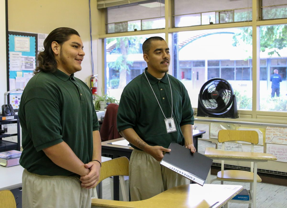Two youth offenders share a project.
