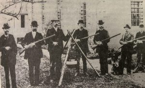 Historic photo of prison staff holding guns.