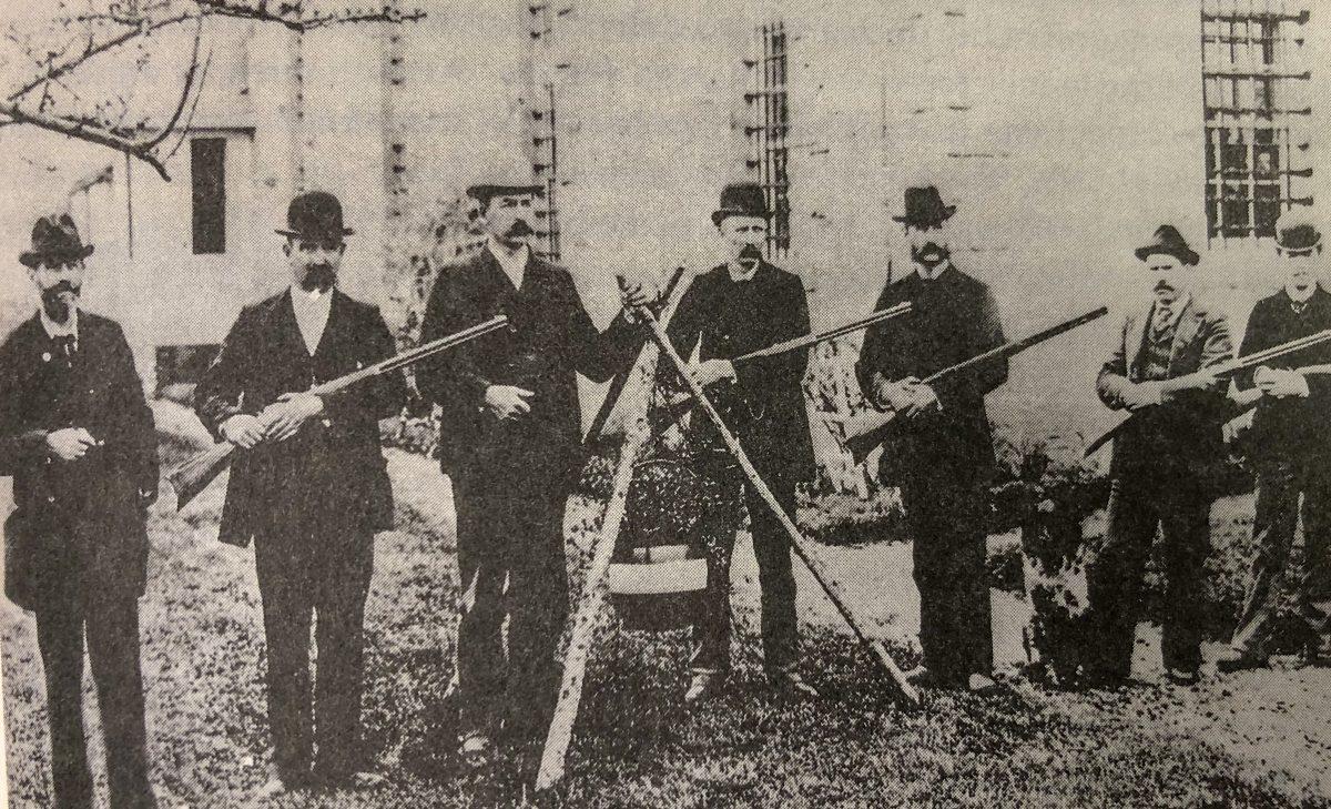 Historic photo of men holding guns.