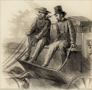 Two people ride a stagecoach.