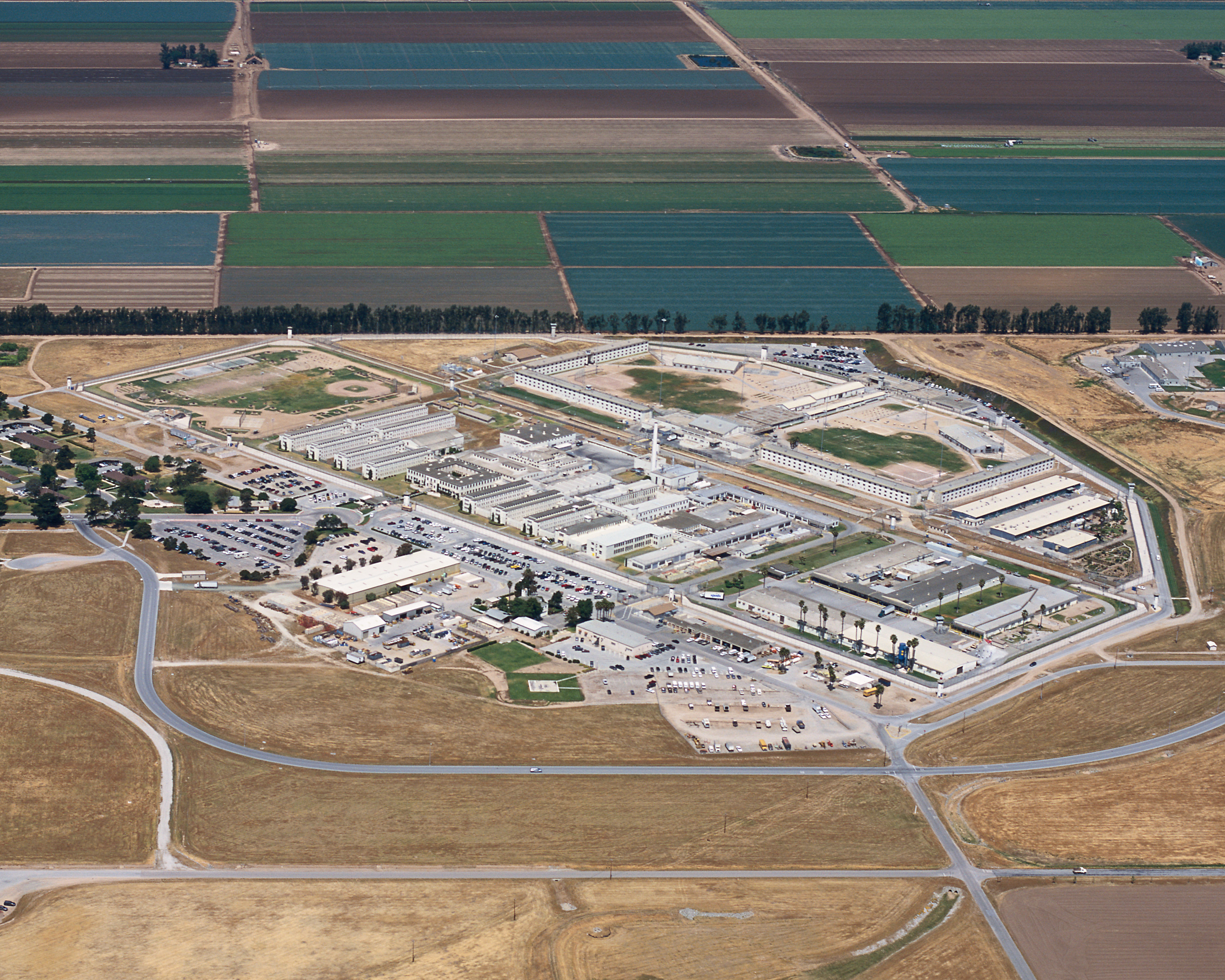 Arial shot of prison surrounded by agricultural land.