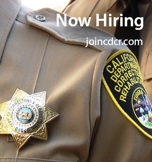 Closeup of correctional officer uniform showing shoulder and badge. Type says Now Hiring, joincdcr.com