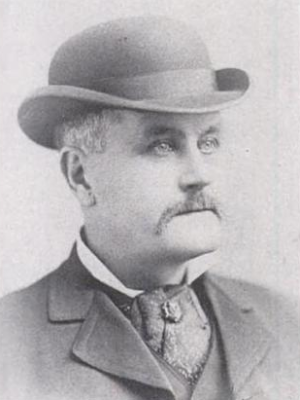 Man with hat, big tie and jacket.