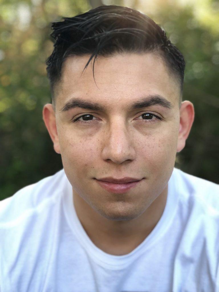 Closeup of young man smiling.