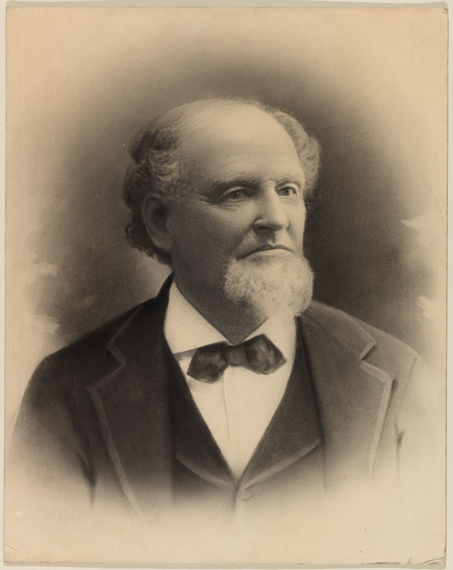 Antique photo of man with white beard wearing a bow tie.