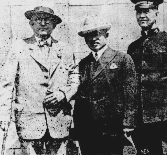 Black and white photo of three men in suit