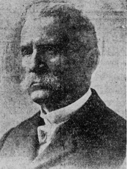 Grainy newspaper photo of man with mustache.