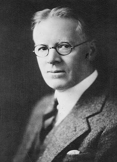 Man in glasses, tie and jacket.