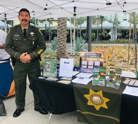 Man in uniform at CDCR booth.