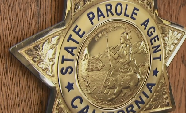 Badge logo with words State Parole Agent California.