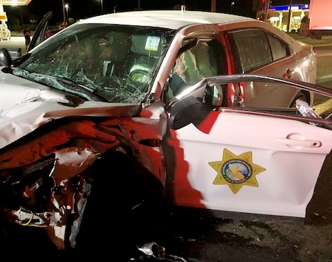 Crushed car with CDCR logo on the door.