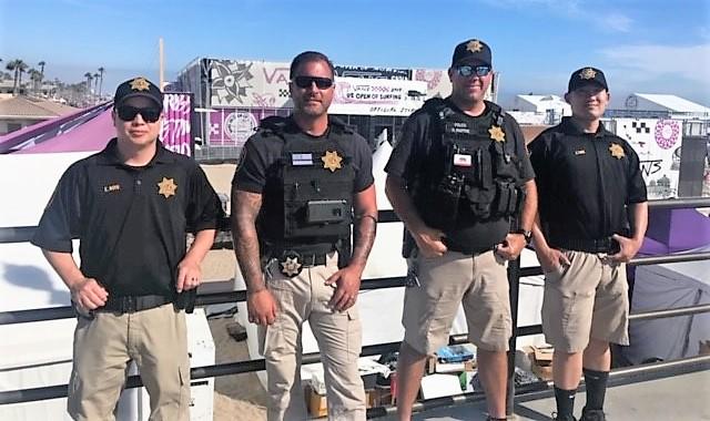 Four men in uniform.