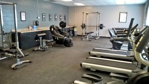 Exercise equipment in a large room.