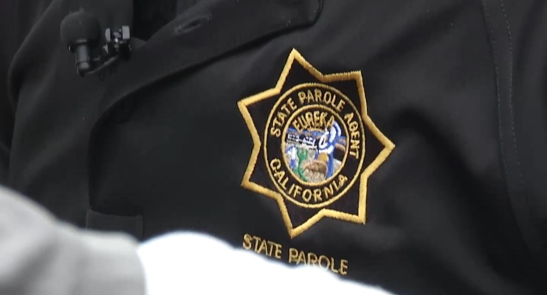 Badge emblem says State Parole Agent California.