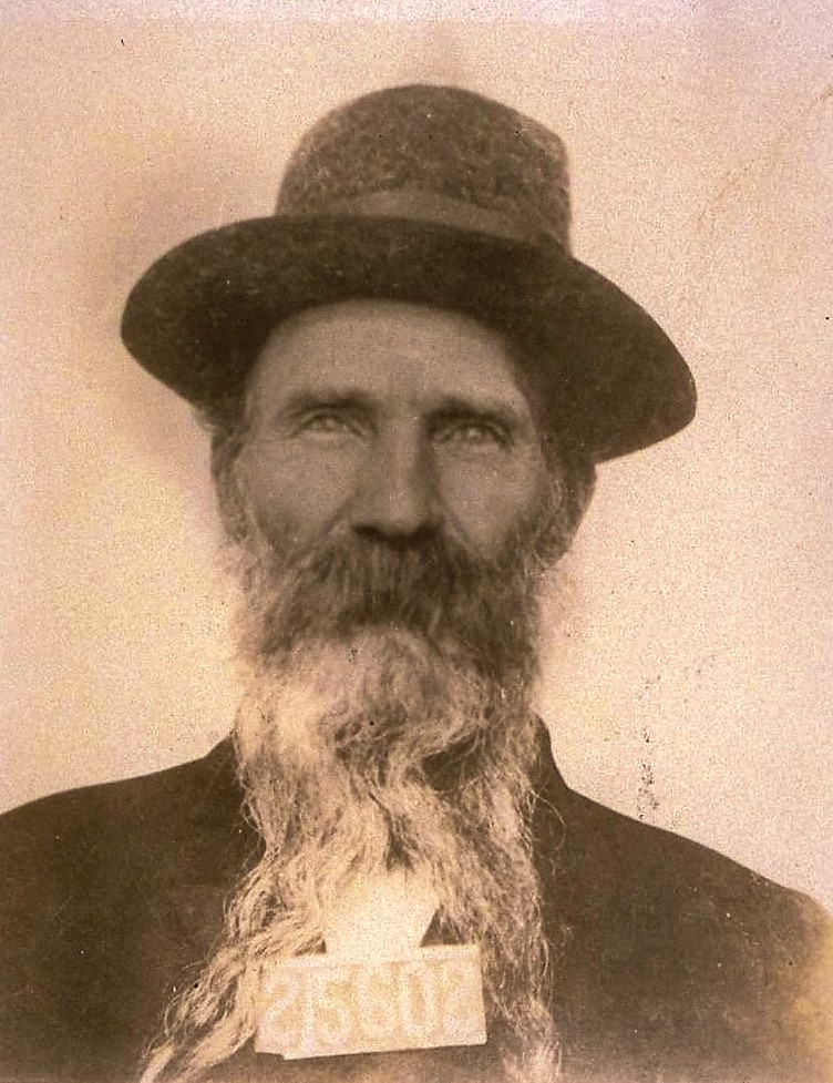 Man in hat and long beard with numbers 25602.