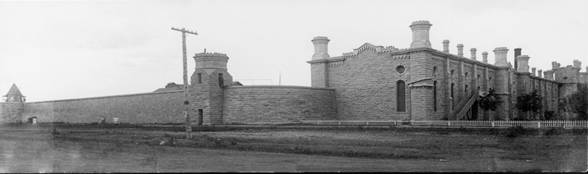 Black and white photo of an old prison.
