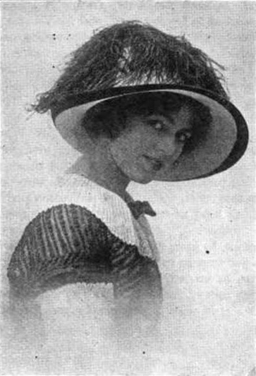 Woman in feathered hat.