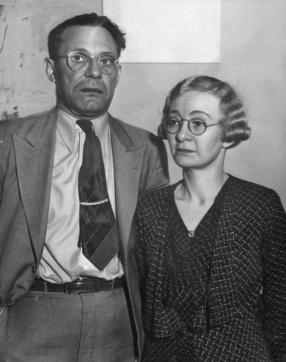 Man and woman wearing glasses.