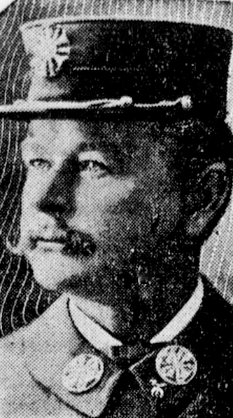 Grainy newspaper photo of man in uniform.