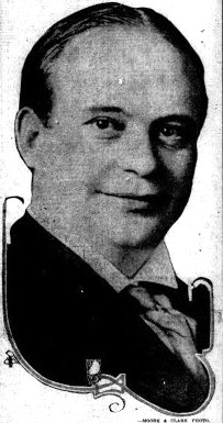 Grainy newspaper photo of a smiling man.