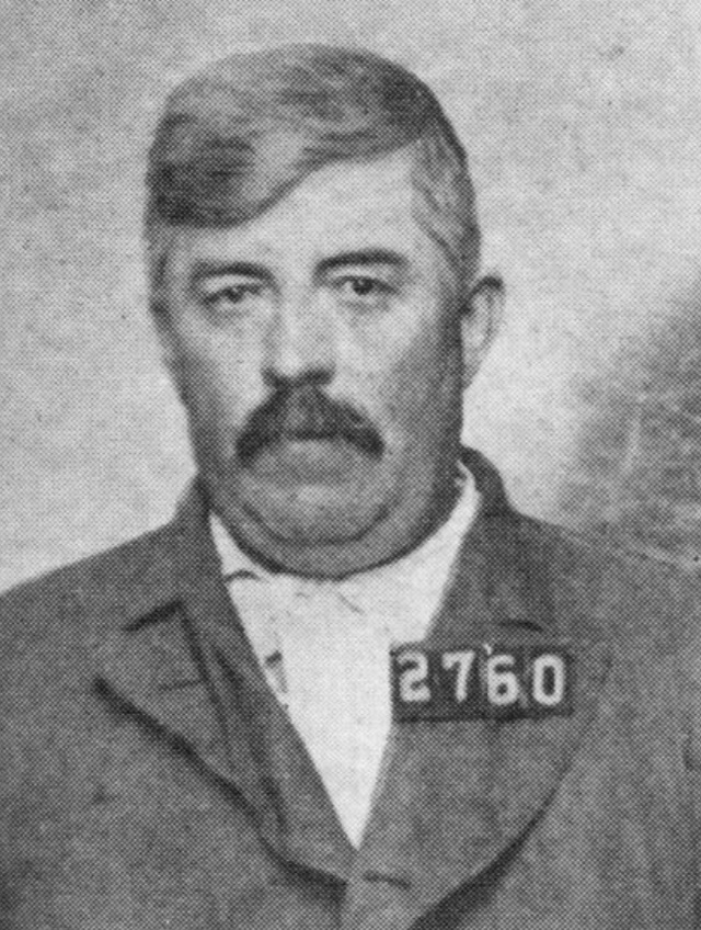 Mugshot of man with 2760 on his chest
