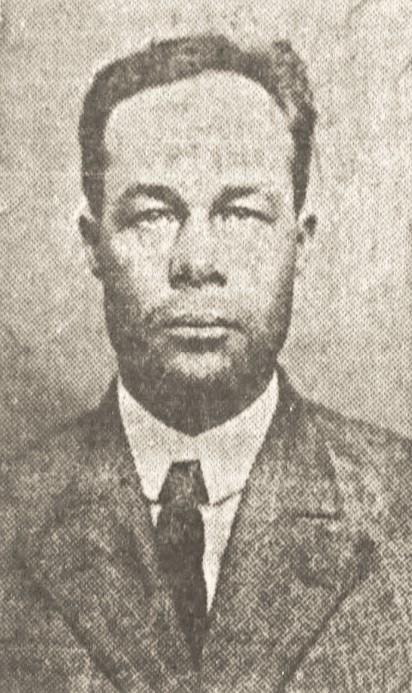 Grainy newspaper photo of man in tie.