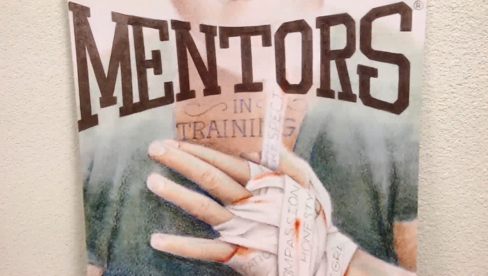 A posted showing a bandaged hand and the words Mentors in Training.