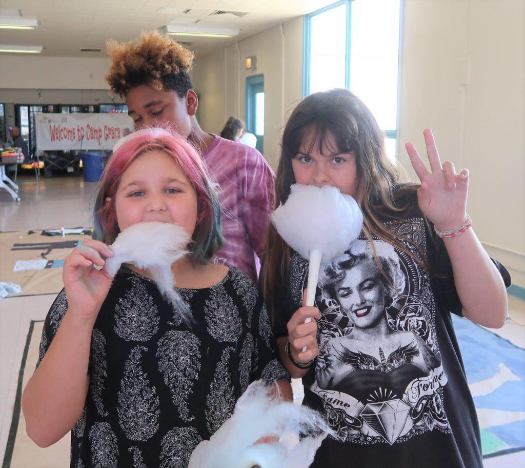 Kids eat cotton candy.