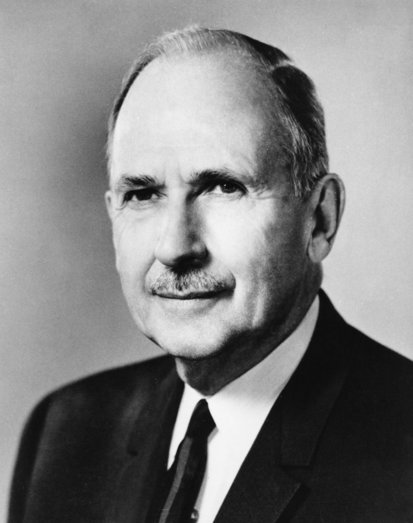Black and white photo of man wearing tie.