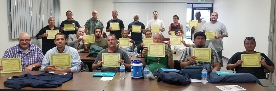 People hold certificates.