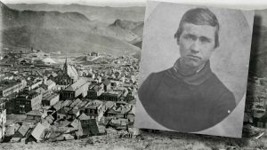 Photo of man superimposed over photo of mountains and a town.