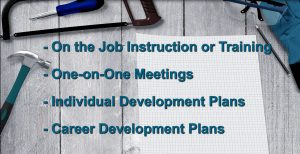A bullet-point list saying On the Job Instruction or Training, One-on-One Meetings, Individual Development Plans, and Career Development Plans.