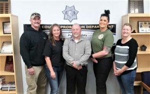 Five CDCR peer support volunteers standing