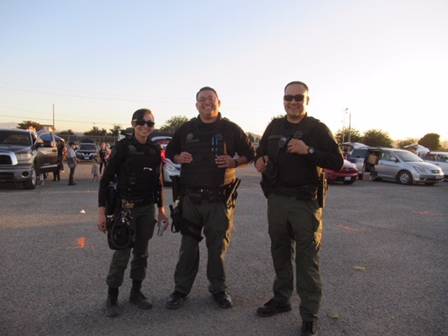 Three correctional officers pose for a photo.
