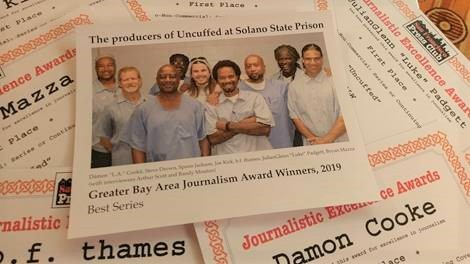 Photo of inmates printed on an awards certificate.