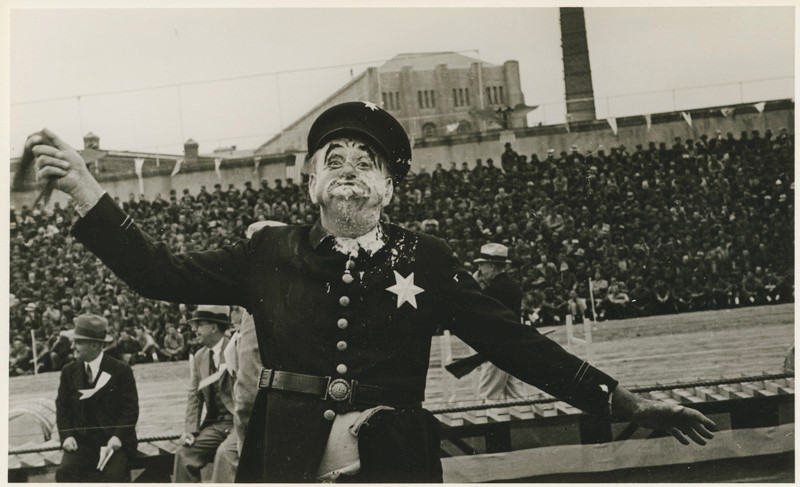 A clown dressed as a police man takes a pie to the face as part Thanksgiving observances for inmates.