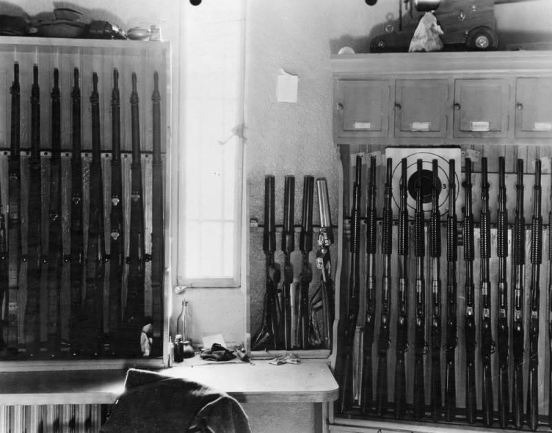Gun in a room line a wall.
