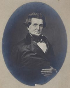 Black and white photo of a man.