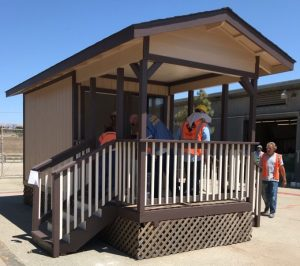 Inmates build a tiny house at a training program in a prison.