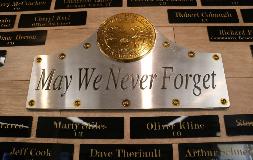 A plaque reads May We Never Forget.