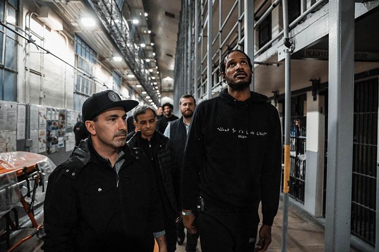 Sacramento Kings players walk through a prison cell block in Folsom.