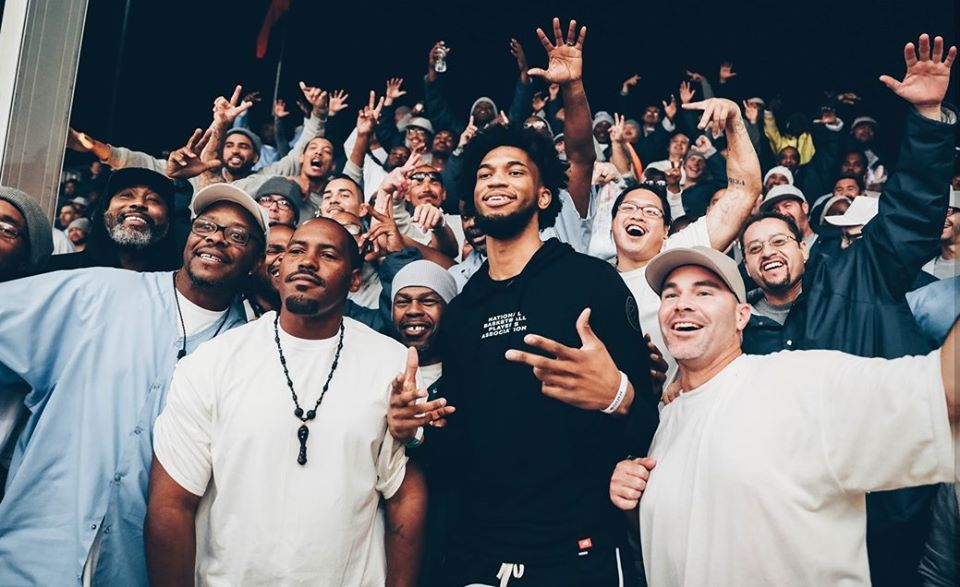 Sacramento Kings player poses with inmates at Folsom Prison.