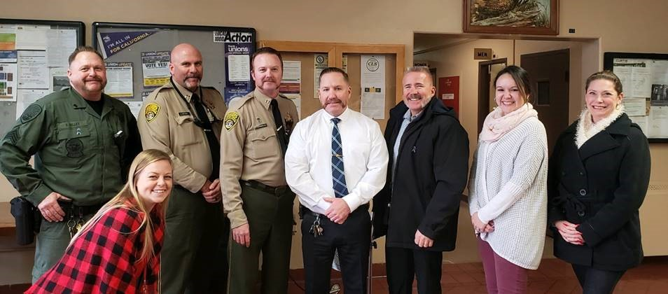 Correctional staff, some sporting mustaches.