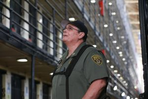 Correctional officer stands on death row at San Quentin.