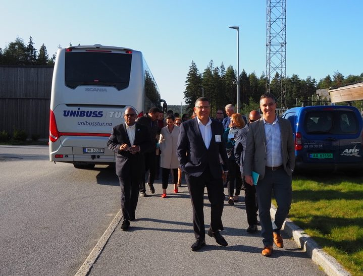 California prison officials steps off a bus and onto a Norway prison site.