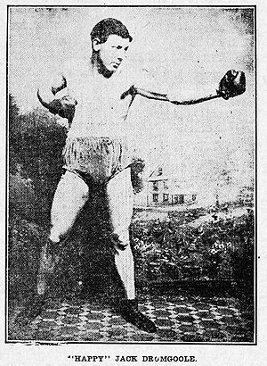 Man in early 20th century boxing gear.