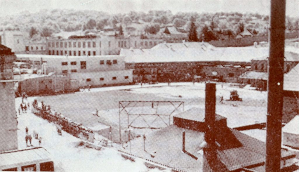 The recreation yard at Folsom prison shows fences and buildings.