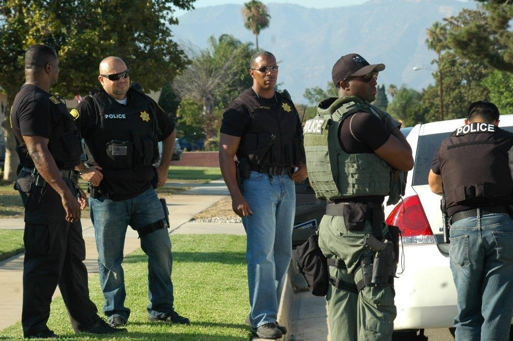 Parole Agent with other officers.
